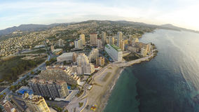 Famous Mediterranean Resort Calpe in Spain / STUNNING VIDEO ALSO. Aerial view of sunny morning on the beach of Calpe, Calp. Penon de Ifach also on the photo Royalty Free Stock Photos