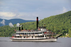 The famous Minnie Ha Ha steamboat taking passengers out on Lake George New York, July,2013 Royalty Free Stock Image