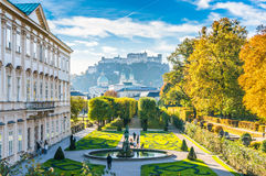 Famous Mirabell Gardens with historic Fortress in Salzburg, Austria. Beautiful view of famous Mirabell Gardens with the old historic Fortress Hohensalzburg in Royalty Free Stock Image
