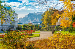 Famous Mirabell Gardens with historic Fortress in Salzburg, Austria. Beautiful view of famous Mirabell Gardens with the old historic Fortress Hohensalzburg in royalty free stock photography