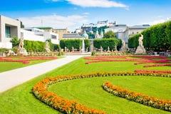 Famous Mirabell Gardens in Salzburg, Austria. Famous Mirabell Gardens with the old historic Fortress Hohensalzburg in the background in Salzburg, Austria stock photography