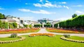 Famous Mirabell Gardens in Salzburg, Austria. Famous Mirabell Gardens with the old historic Fortress Hohensalzburg in the background in Salzburg, Austria stock photos