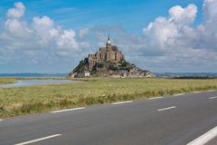 Famous Mont Saint - Michel. Mont Saint-Michel (France) seen by the road. It is a very known touristic place in France and not only, for his architecture, because Royalty Free Stock Photography