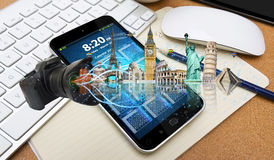 Famous monuments of the world going out of a mobile phone Stock Image