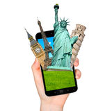Famous monuments of the world going out of a mobile phone on whi Royalty Free Stock Photos