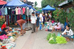 Famous morning market and female sellers in Luang Prabang,Laos. Women are selling fruits and vegetables and other stuff at the famous morning market in Luang stock photography