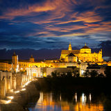 Famous Mosque (Mezquita) and  Roman Bridge at beautiful night, Stock Photo