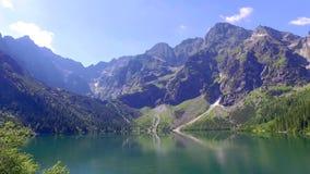 Famous mountain lake in the Tatras mountains at sunrise, Poland stock video