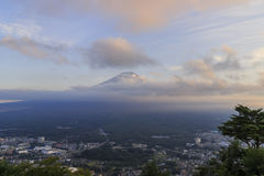 The famous Mt. Fuji at Kawaguchi, Japan. With city below around sunset time stock image
