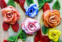 Famous murano glass. Coloured glass flowers on wooden background. Shop in Murano, Venice, Italy. Stock Image