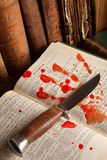 Famous murderer 3. Shakespeare's Macbeth with old books and a blood hand Royalty Free Stock Photo