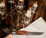 Famous murderer 8. Shakespeare's Macbeth with old books and a candlestick Royalty Free Stock Images