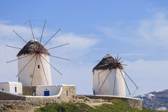 The famous Mykonos windmills. Two of the famous windmills in Mykonos, Greece during a clear and bright summer sunny day royalty free stock images