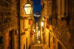 Famous narrow alley of Dubrovnik old town, Croatia. Famous narrow alley of Dubrovnik old town in Croatia at night - Prominent travel destination of Croatia royalty free stock images