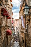 Famous narrow alley of Dubrovnik old town, Croatia. Famous narrow alley of Dubrovnik old town in Croatia - Prominent travel destination of Croatia. Dubrovnik old royalty free stock photos
