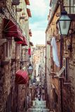 Famous narrow alley of Dubrovnik old town, Croatia. Famous narrow alley of Dubrovnik old town in Croatia - Prominent travel destination of Croatia. Dubrovnik old stock photography