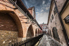 Famous narrow medieval architecture building street in old town Stock Image