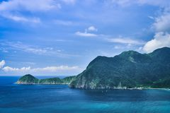 Wushihbi Coast Landscape - Famous natural spot of Yilan, Taiwan. Birds eye aerial view with morning blue bright sky and sunlight. royalty free stock images