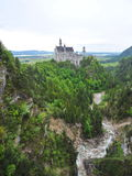 Famous Neuschwanstein Castle overlooking the surrounding valley and meadow Stock Photography