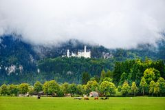 Famous Neuschwanstein Castle, fairy-tale palace on a rugged hill above the village of Hohenschwangau near Fussen Royalty Free Stock Images