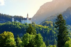 Famous Neuschwanstein Castle, 19th-century Romanesque Revival palace on a rugged hill above the village of Hohenschwangau in south. Famous Neuschwanstein Castle stock photos
