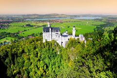 Famous Neuschwanstein Castle, 19th-century Romanesque Revival palace on a rugged hill above the village of Hohenschwangau in south royalty free stock images
