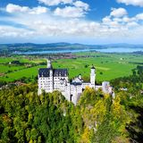 Famous Neuschwanstein Castle, 19th-century Romanesque Revival palace on a rugged hill above the village of Hohenschwangau in south. Famous Neuschwanstein Castle stock image