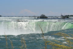 Famous Niagara Fall on a summer day. The famous Niagara Fall on a summer day royalty free stock images