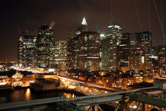 Famous night view New York to Manhattan from Brooklyn bridge, US Royalty Free Stock Photo