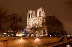 The famous Notre Dame at night in Paris Stock Photo