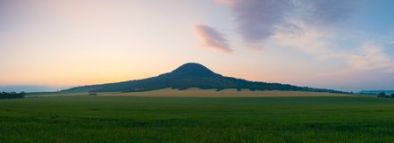 Famous Oblik hill in Czech Bohemian Uplands, Czech Republic. Oblik hill. Czech Republic. It is the unique basanite hill about 6 km northwards from Louny.One of stock photo