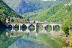 Famous old bridge on drina river. Famous historic bridge on drina river, visegrad city, bosnia and herzegovina stock image