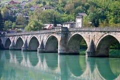 Famous old bridge on drina river. Famous historic bridge on drina river, visegrad city, bosnia and herzegovina stock images