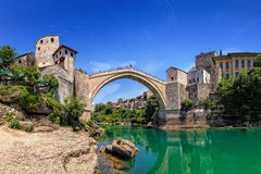 Famous Old Bridge in Mostar. The Old Bridge in Mostar with emerald river Neretva. Bosnia and Herzegovina Stock Photo