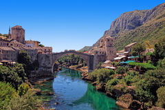 Famous Old Bridge in Mostar. The Old Bridge in Mostar with emerald river Neretva. Bosnia and Herzegovina Royalty Free Stock Images