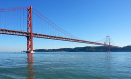 Famous old bridge over river Tejo Royalty Free Stock Photography