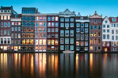 Famous old buildings with lights in Amsterdam Stock Image