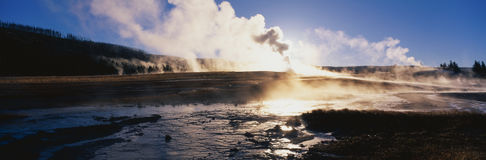 Famous Old Faithful Geyser. This is the famous Old Faithful Geyser. The geyser is erupting at sunrise stock image