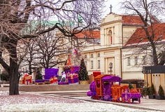 Famous old  town of Warsaw with church, christmas tree, toy train and gifts. Poland. Famous old  town of Warsaw with church (temple), christmas tree, toy train Royalty Free Stock Images