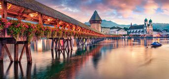 Free Famous Old Wooden Chapel Bridge Kapellbrucke, Landmark 1300s Wooden Bridge With Grand Stone Water Tower & A Roof Decorated With Royalty Free Stock Photos - 209612368