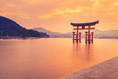 The famous orange shinto gate (Torii) of Miyajima island, Hiroshima prefecture, Japan. Stock Photo