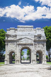 The famous Orange triumphal arch under white clouds. France Royalty Free Stock Images