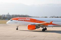 Geneva/Switzerland – 03.03.2019 : Easyjet airplane on the tarmac of geneva international airport stock images