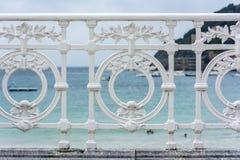 Famous ornamental iron fence in La Concha beach, San Sebastian Stock Image
