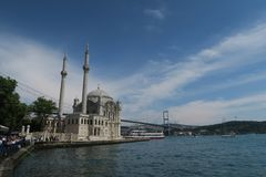 Famous Ortakoy Mosque with Bosphorus Bridge - Connection between Europe and Asia in Istanbul, Turkey. Ortakoy Mosque at the European Side of Istanbul, with the Royalty Free Stock Photography
