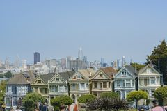 The famous Painted Ladies. San Francisco, AUG 18: Afternoon view of the famous Painted Ladies with downtown building on AUG 18, 2018 at San Francisco, California stock photo