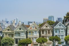 The famous Painted Ladies. San Francisco, AUG 18: Afternoon view of the famous Painted Ladies with downtown building on AUG 18, 2018 at San Francisco, California royalty free stock photography