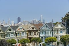 The famous Painted Ladies. San Francisco, AUG 18: Afternoon view of the famous Painted Ladies with downtown building on AUG 18, 2018 at San Francisco, California royalty free stock photos