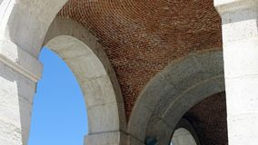 Architectural detail of arches. Royal Palace of Aranjuez on a sunny summer day. Spain. The famous Palace of Aranjuez on a sunny summer day. Architectural detail Royalty Free Stock Photography