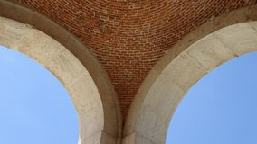 Architectural detail of arches. Royal Palace of Aranjuez on a sunny summer day. Spain. The famous Palace of Aranjuez on a sunny summer day. Architectural detail Stock Photos